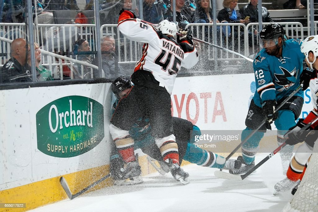 Logan Couture #39 of the San Jose Sharks take a hit from Sami Vatanen #45 of the Anaheim Ducks at SAP Center at San Jose on March 18, 2017 in San Jose, California.