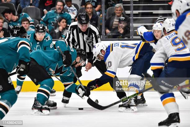 Logan Couture of the San Jose Sharks takes a faceoff against Brayden Schenn of the St Louis Blues in Game Two of the Western Conference Final during...