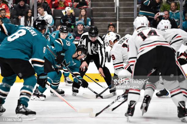 Logan Couture of the San Jose Sharks takes a faceoff against Jonathan Toews of the Chicago Blackhawks at SAP Center on March 3 2019 in San Jose...