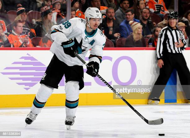 Logan Couture of the San Jose Sharks takes the puck in the second period against the Philadelphia Flyers on November 28 2017 at Wells Fargo Center in...