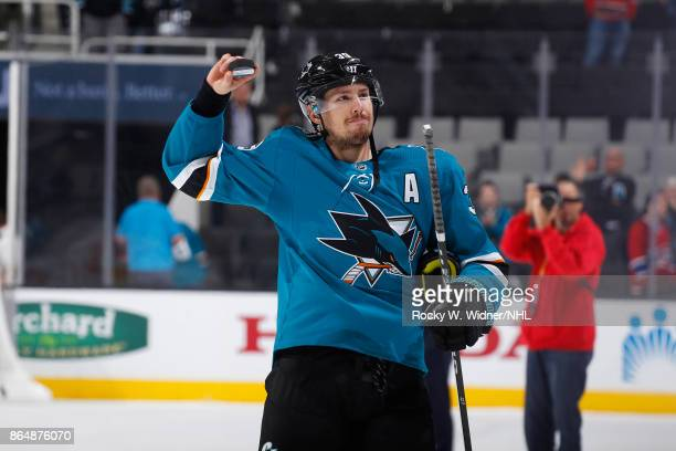 Logan Couture of the San Jose Sharks tosses pucks to fans after defeating the Montreal Canadiens at SAP Center on October 17 2017 in San Jose...