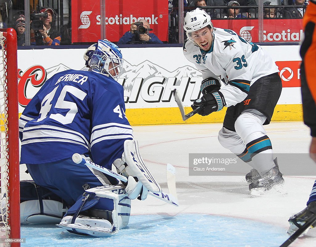 Logan Couture #39 of the San Jose Sharks waits for a puck in front of Jonathan Bernier #45 of the Toronto Maple Leafs during an NHL game at the Air Canada Centre on March 19, 2015 in Toronto, Ontario, Canada. The Sharks defeated the Leafs 4-1.