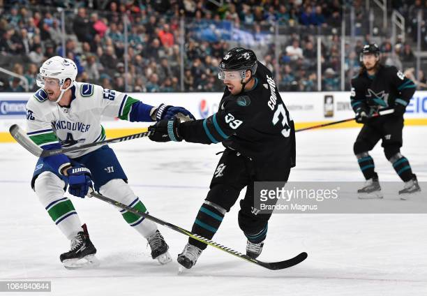 Logan Couture takes a shot on goal against Tim Schaller of the Vancouver Canucks at SAP Center on November 23 2018 in San Jose California