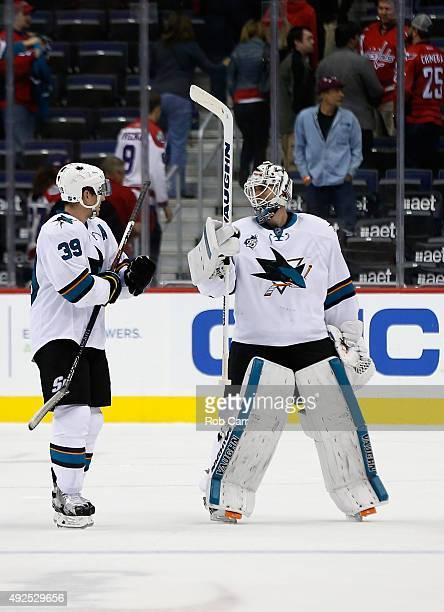 Logan Couture talks with goalie Martin Jones of the San Jose Sharks following the Sharks 50 win over the Washington Capitals at Verizon Center on...