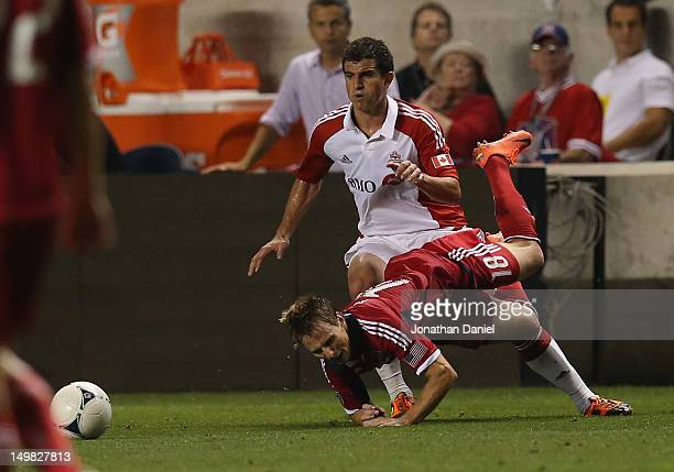 Logan Emory of Toronto FC during knocks down Chris Rolfe of the Chicago Fire to earn a yellow card an MLS match at Toyota Park on August 4 2012 in...