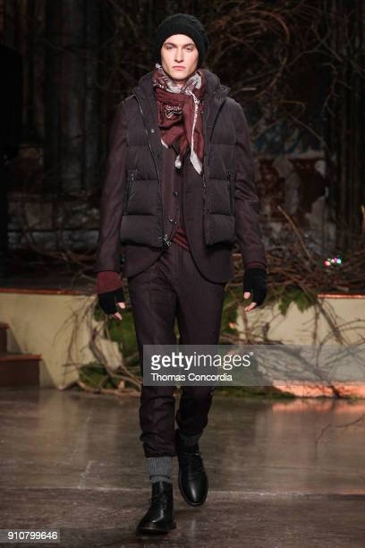 Logan Flatte walks the runway wearing John Varvatos Fall/Winter 2018 with makeup by Chika Chan for MakeUp Pro and Hair by Yannik D'Is for...