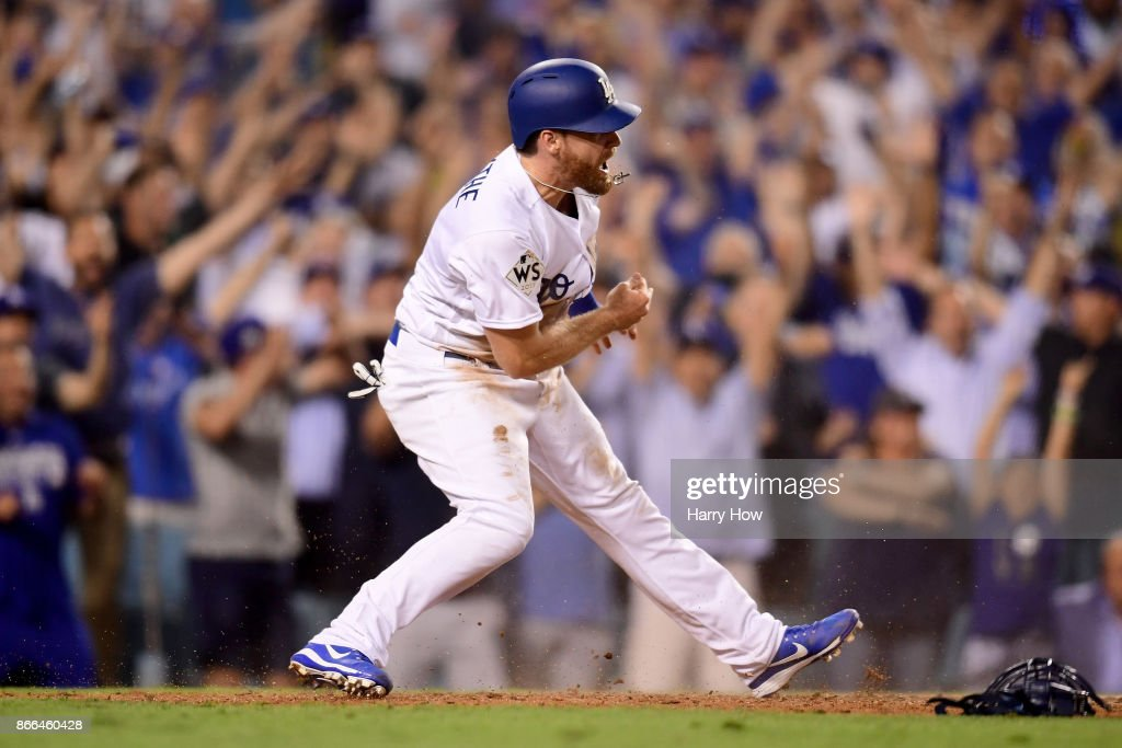 Logan Forsythe #11 of the Los Angeles Dodgers celebrates scoring a run on a RBI single hit by Enrique Hernandez #14 (not pictured) to tie the game 5-5 during the tenth inning against the Houston Astros in game two of the 2017 World Series at Dodger Stadium on October 25, 2017 in Los Angeles, California.