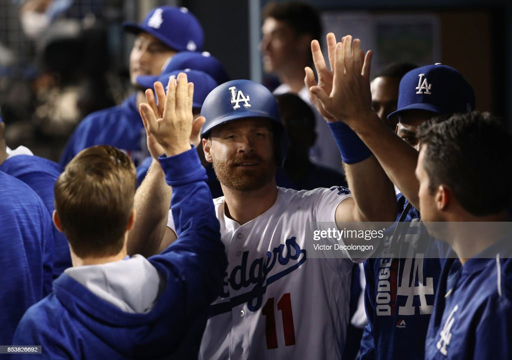 Logan Forsythe #11 of the Los Angeles Dodgers celebrates with teammates after scoring during the third inning of the MLB game against the San Francisco Giants at Dodger Stadium on September 22, 2017 in Los Angeles, California. The Dodgers defeated the San Francisco Giants 4-2 to clinch their fifth straight National League West title.