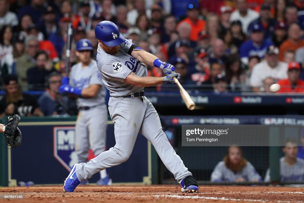 Logan Forsythe #11 of the Los Angeles Dodgers hits a RBI single during the seventh inning against the Houston Astros in game four of the 2017 World Series at Minute Maid Park on October 28, 2017 in Houston, Texas.