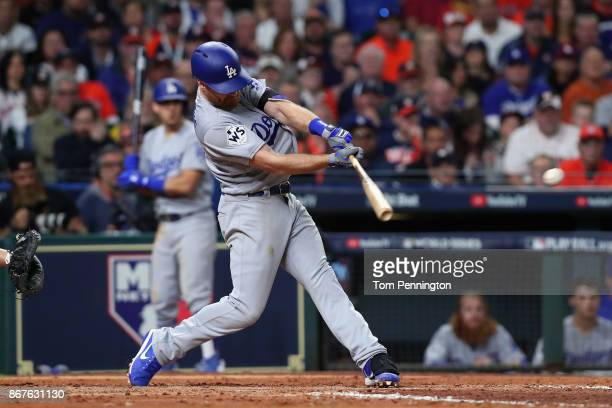 Logan Forsythe of the Los Angeles Dodgers hits a RBI single during the seventh inning against the Houston Astros in game four of the 2017 World...