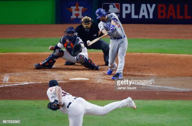 Logan Forsythe of the Los Angeles Dodgers hits a RBI single during the seventh inning against Will Harris of the Houston Astros in game four of the...