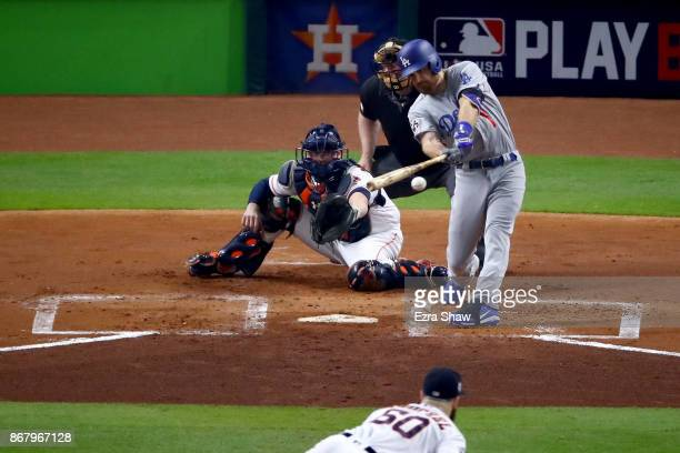 Logan Forsythe of the Los Angeles Dodgers hits a RBI single during the first inning against the Houston Astros in game five of the 2017 World Series...