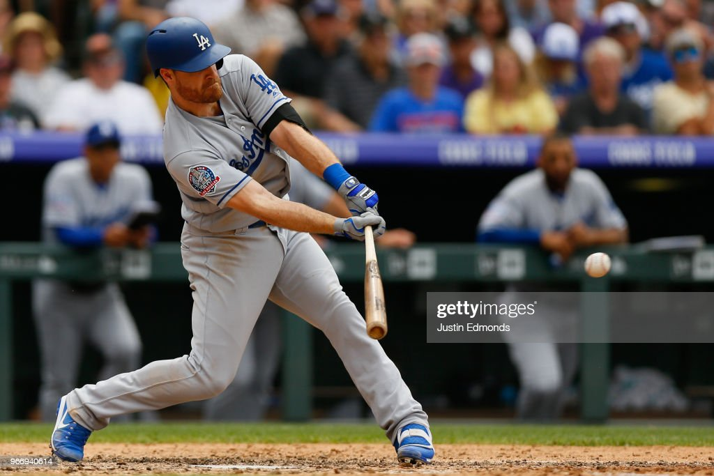 Logan Forsythe #11 of the Los Angeles Dodgers hits an RBI single during the sixth inning against the Colorado Rockies at Coors Field on June 3, 2018 in Denver, Colorado.