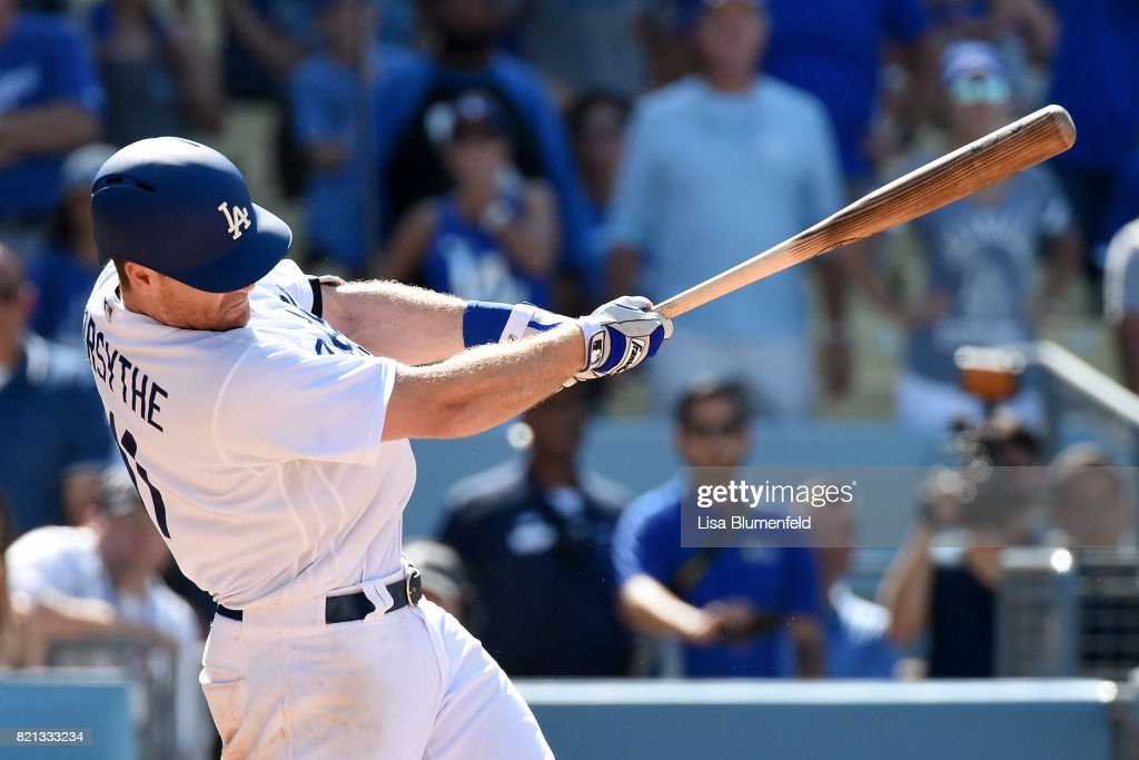 Logan Forsythe #11 of the Los Angeles Dodgers hits the game winning single in the tenth inning to defeat the Atlanta Braves 5-4 at Dodger Stadium on July 23, 2017 in Los Angeles, California.
