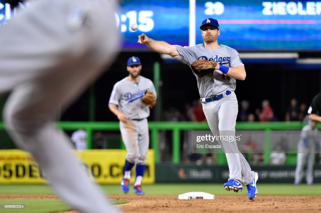 Logan Forsythe #11 of the Los Angeles Dodgers throws towards first base in the eighth inning against the Miami Marlins at Marlins Park on May 15, 2018 in Miami, Florida.