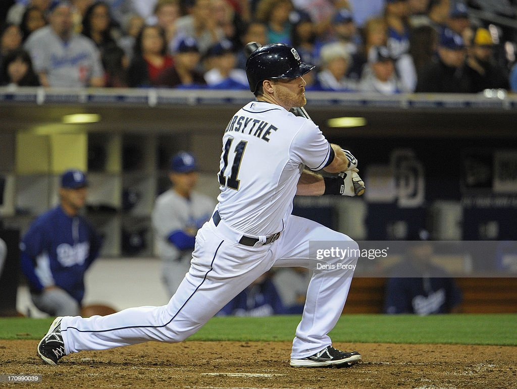Logan Forsythe #11 of the San Diego Padres hits an RBI single during the fifth inning of a baseball game against the Los Angeles Dodgers at Petco Park on June 20, 2013 in San Diego, California.