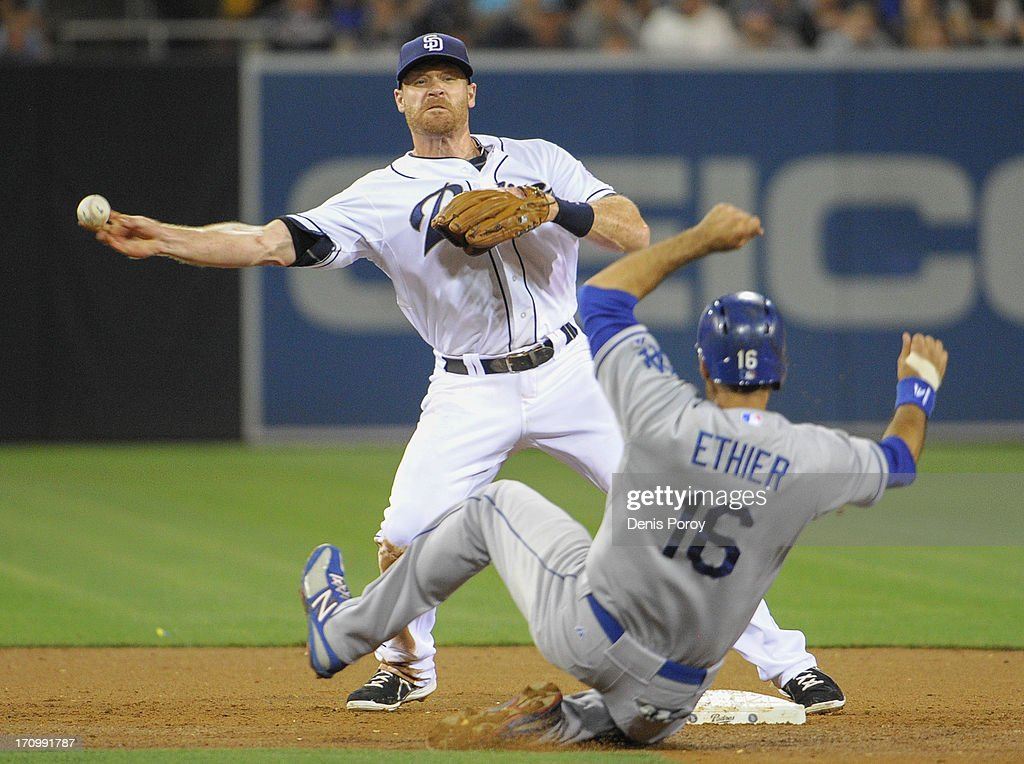 Logan Forsythe #11 of the San Diego Padres throws over Andre Ethier #16 of the Los Angeles Dodgers to turn a double play during the sixth inning of a baseball game at Petco Park on June 20, 2013 in San Diego, California.
