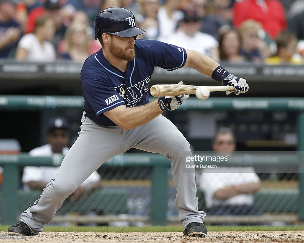 Logan Forsythe #10 of the Tampa Bay Rays bunts for a RBI-single during the sixth inning, driving in Evan Longoria against the Detroit Tigers, at Comerica Park on July 5, 2014 in Detroit, Michigan.