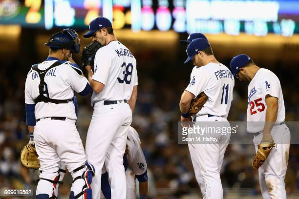 Logan Forsythe Rob Segedin and Yasmani Grandal of the Los Angeles Dodgers talk with Brandon McCarthy of the Los Angeles Dodgers during the fifth...