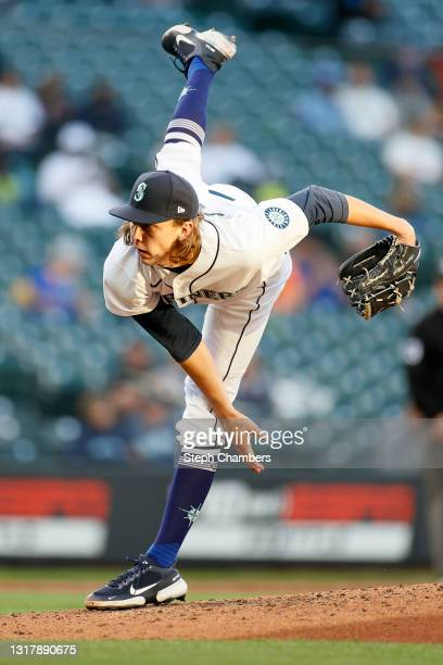 Logan Gilbert of the Seattle Mariners pitches during the third inning against the Cleveland Indians in his MLB debut at T-Mobile Park on May 13, 2021...