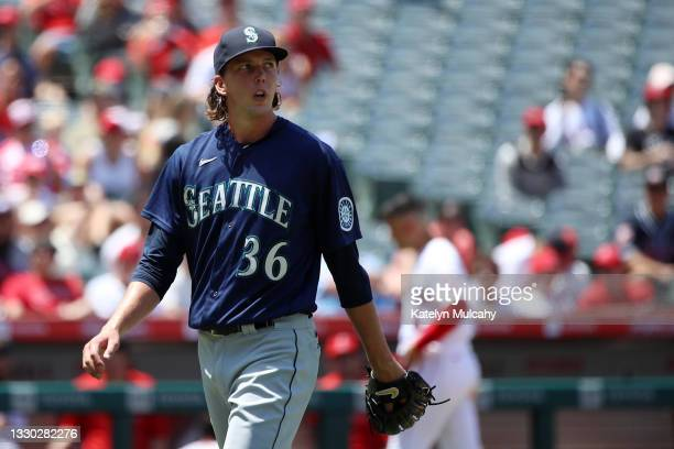 Logan Gilbert of the Seattle Mariners reacts after the final out with bases loaded at the end of the third inning against the Los Angeles Angels at...
