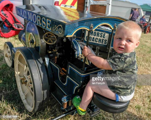 Logan Hayes from York sits on the seat of his fathers miniature steam engine during the final day of the Whitby Traction Engine Rally on August 5,...