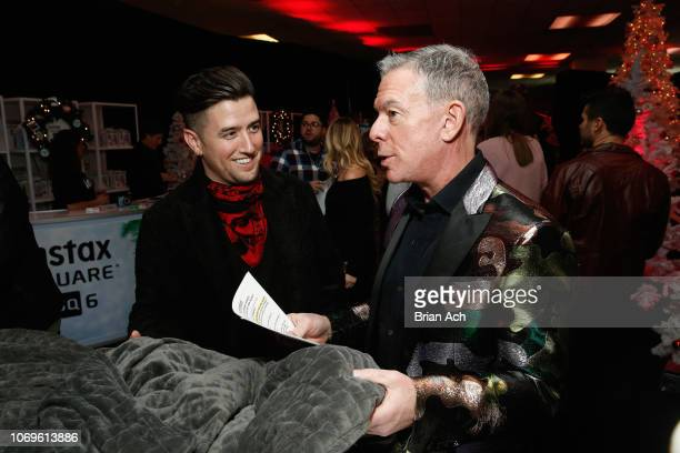 Logan Henderson and Elvis Duran attend the Z100's Jingle Ball 2018 Gift Lounge at Madison Square Garden on December 7 2018 in New York City