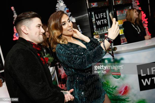 Logan Henderson and Shelley Rome attend the Z100's Jingle Ball 2018 Gift Lounge at Madison Square Garden on December 7 2018 in New York City
