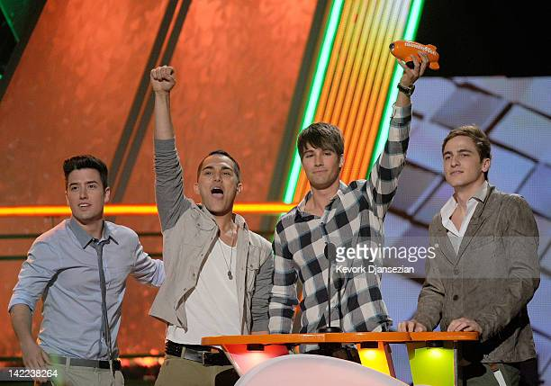 Logan Henderson Carlos Pena James Maslow and Kendall Schmidt of Big Time Rush accept award for Favorite Music Group at Nickelodeon's 25th Annual...