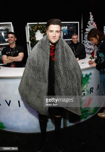 Logan Henderson wears a Gravity blanket in the Z100's Jingle Ball 2018 Gift Lounge at Madison Square Garden on December 7 2018 in New York City
