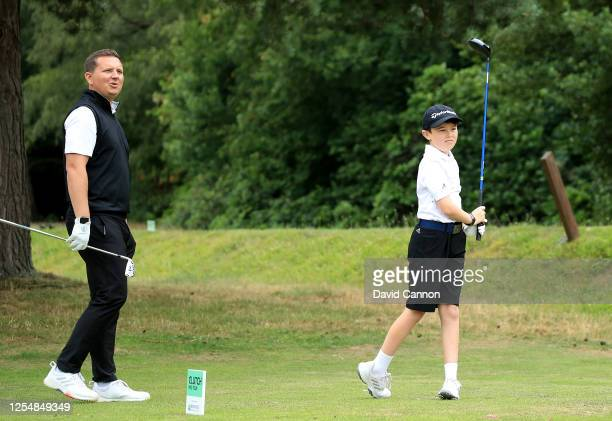 Logan Hodgson of England hits a shot watched by Tom Reid of England the club professional at Sunningdale Heath during the pro-am at Sunningdale Heath...