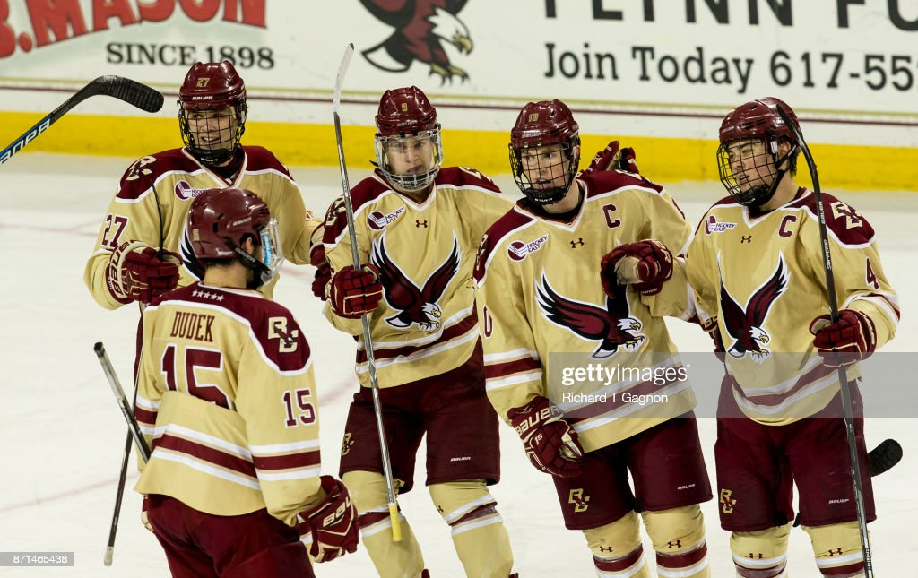 Logan Hutsko #9, Chris Brown #10, JD Dudek #15 and Graham McPhee #27 all of the Boston College Eagles celebrate a goal by teammate Michael Kim #4 against the Connecticut Huskies during NCAA hockey at Kelley Rink on November 7, 2017 in Chestnut Hill, Massachusetts. The Eagles won 2-1.