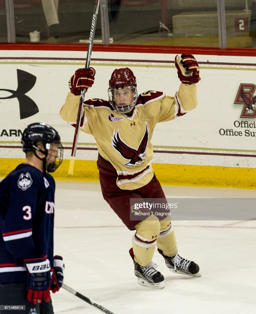 Logan Hutsko #9 of the Boston College Eagles celebrates a goal by his teammate Michael Kim #4 (not pictured) against the Connecticut Huskies during NCAA hockey at Kelley Rink on November 7, 2017 in Chestnut Hill, Massachusetts.