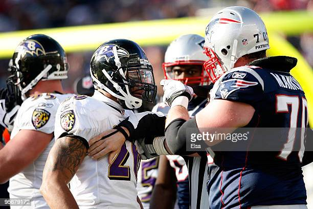 Logan Mankins of the New England Patriots and Ed Reed of the Baltimore Ravens get in each others face during the 2010 AFC wild-card playoff game at...
