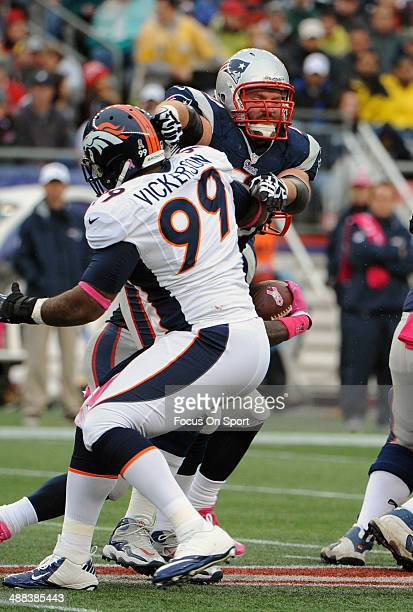 Logan Mankins of the New England Patriots blocks Kevin Vickerson of the Denver Broncos during an NFL football game October 7, 2012 at Gillette...
