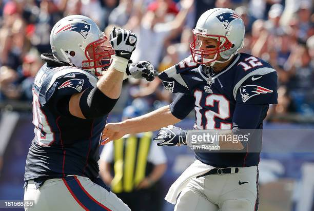 Logan Mankins of the New England Patriots celebrates a touchdown with Tom Brady in the 2nd half in a game with the Tampa Bay Buccaneers at Gillette...