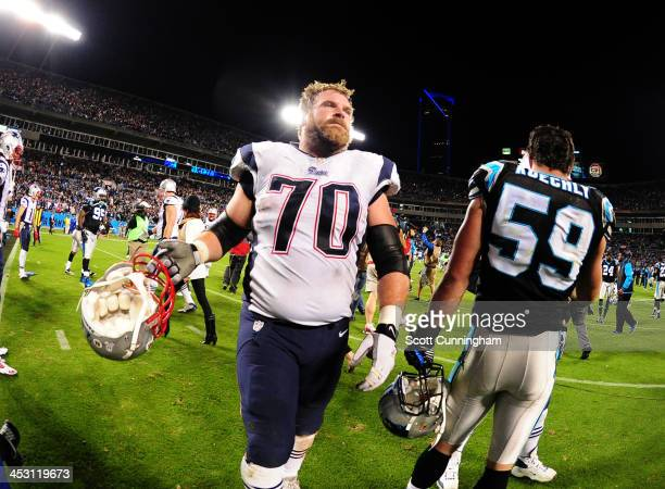 Logan Mankins of the New England Patriots heads off the field after the game against the Carolina Panthers at Bank of America Stadium on November 18,...