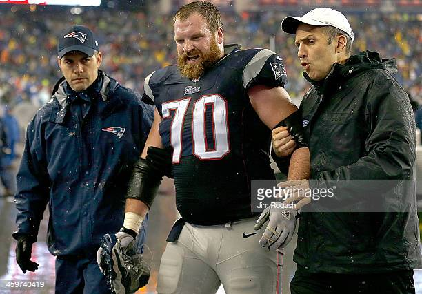 Logan Mankins of the New England Patriots leaves the field with an injury during a game with the Buffalo Bills at Gillette Stadium on December 29,...
