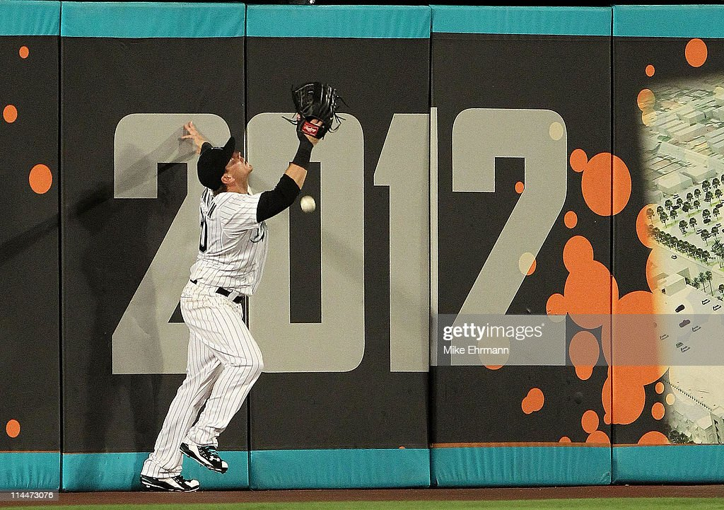 Logan Morrison #20 of the Florida Marlins imisplays a fly ball during a game against the Tampa Bay Rays at Sun Life Stadium on May 20, 2011 in Miami Gardens, Florida.