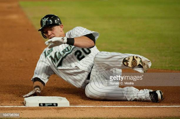 Logan Morrison of the Florida Marlins slides into third base during a MLB game against the Pittsburgh Pirates at Sun Life Stadium on October 1 2010...