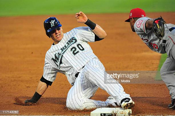 Logan Morrison of the Florida Marlins slides into third base during a MLB game against the Los Angeles Angels at Sun Life Stadium on June 21 2011 in...