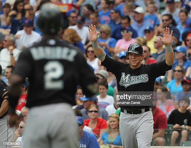 Logan Morrison of the Florida Marlins welcomes teammate Hanley Ramirez as they score runs in the 5th inning against the Chicago Cubs at Wrigley Field...