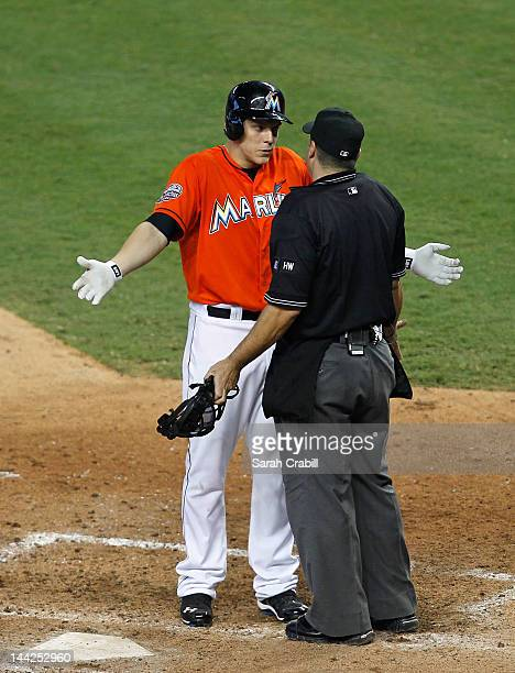 Logan Morrison of the Miami Marlins argues with the umpire after striking out during a game against the New York Mets at Marlins Park on May 12 2012...