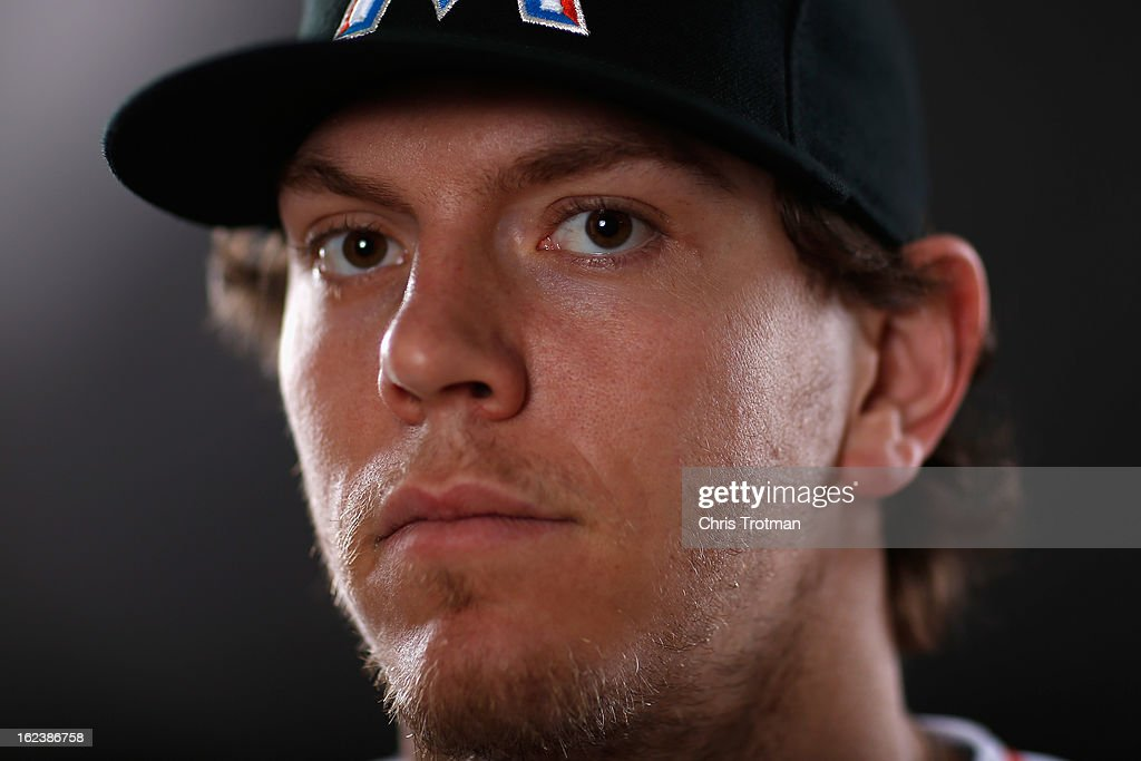 Logan Morrison #5 of the Miami Marlins poses for a photograph at spring training media photo day at Roger Dean Stadium on February 22, 2013 in Jupiter, Florida.