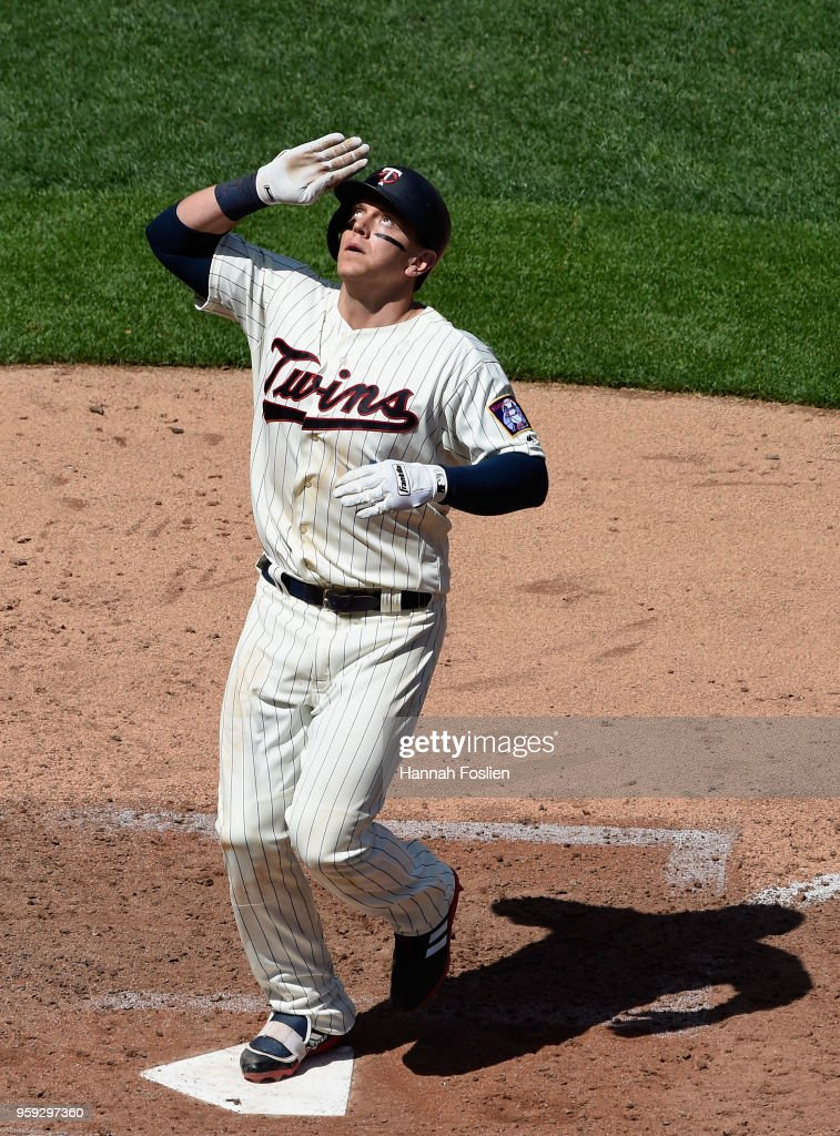 Logan Morrison #99 of the Minnesota Twins celebrates as he crosses home plate after hitting a solo home run against the St. Louis Cardinals during the sixth inning of the interleague game on May 16, 2018 at Target Field in Minneapolis, Minnesota. The Cardinals defeated the Twins 7-5.