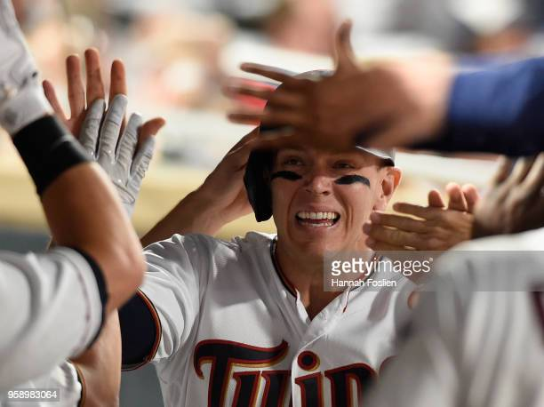 Logan Morrison of the Minnesota Twins celebrates scoring a run against the St Louis Cardinals during the seventh inning of the interleague game on...