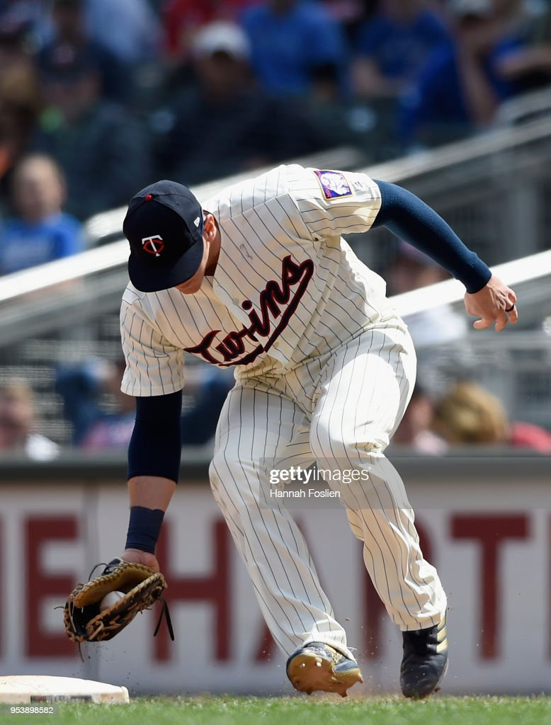 Logan Morrison #99 of the Minnesota Twins fields the ball hit by Kendrys Morales #8 of the Toronto Blue Jays during the ninth inning of the game on May 2, 2018 at Target Field in Minneapolis, Minnesota. The Twins defeated the Blue Jays 4-0.