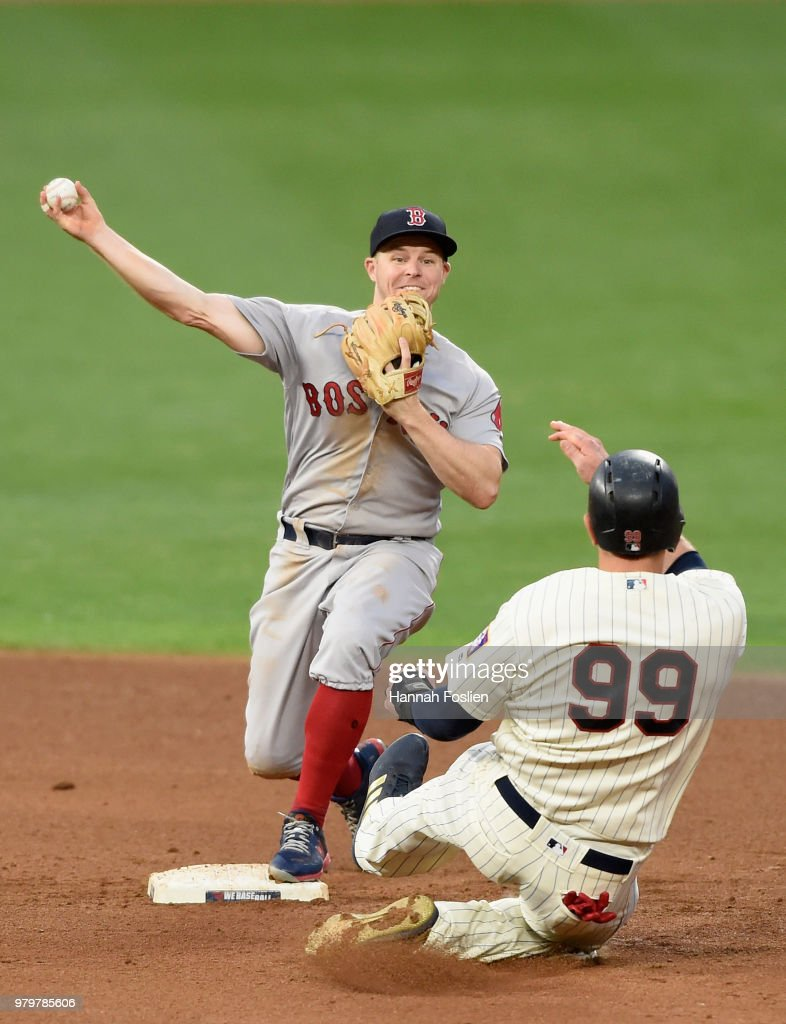 Logan Morrison #99 of the Minnesota Twins is out at second base as Brock Holt #12 of the Boston Red Sox turns a double play during the fourth inning of the game on June 20, 2018 at Target Field in Minneapolis, Minnesota.