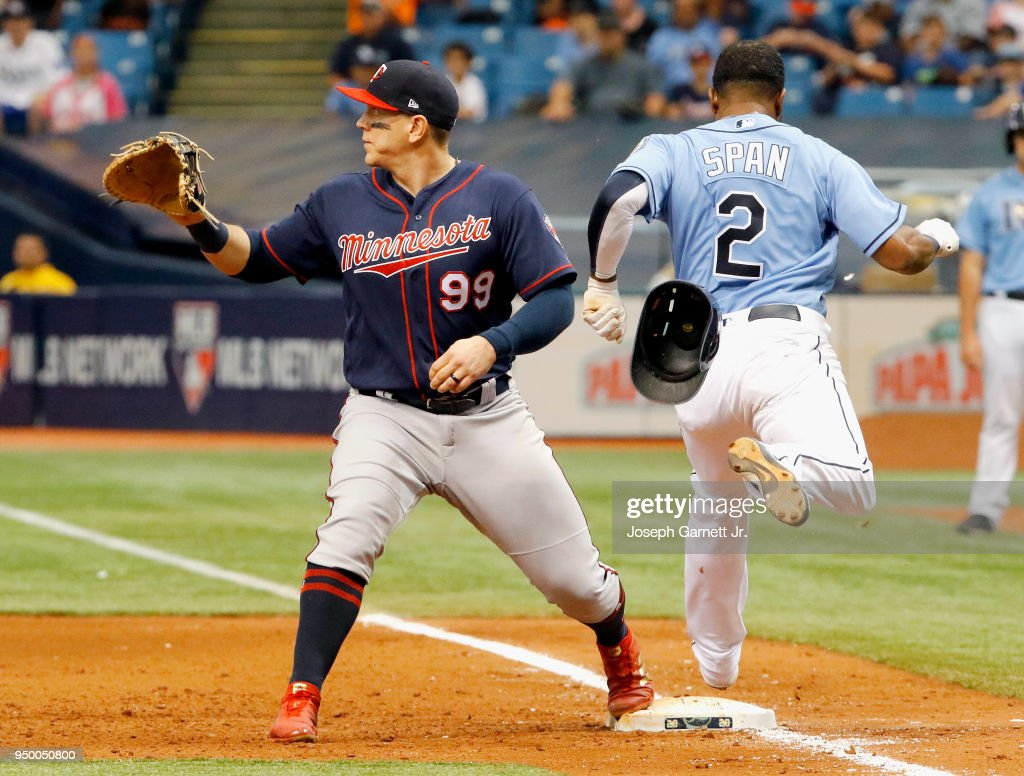 Logan Morrison #99 of the Minnesota Twins waits on the ball as Denard Span #2 of the Tampa Bay Rays reaches first base safely during the sixth inning of their game at Tropicana Field on April 22, 2018 in St. Petersburg, Florida.