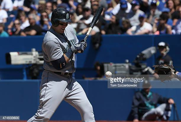 Logan Morrison of the Seattle Mariners is hit by pitch in the seventh inning during MLB game action against the Toronto Blue Jays on May 23 2015 at...